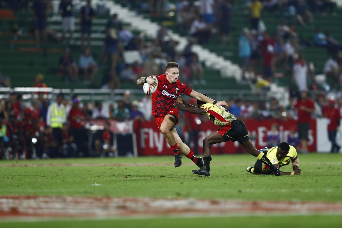 a rugby sevens player in Dubai dodging a tackle